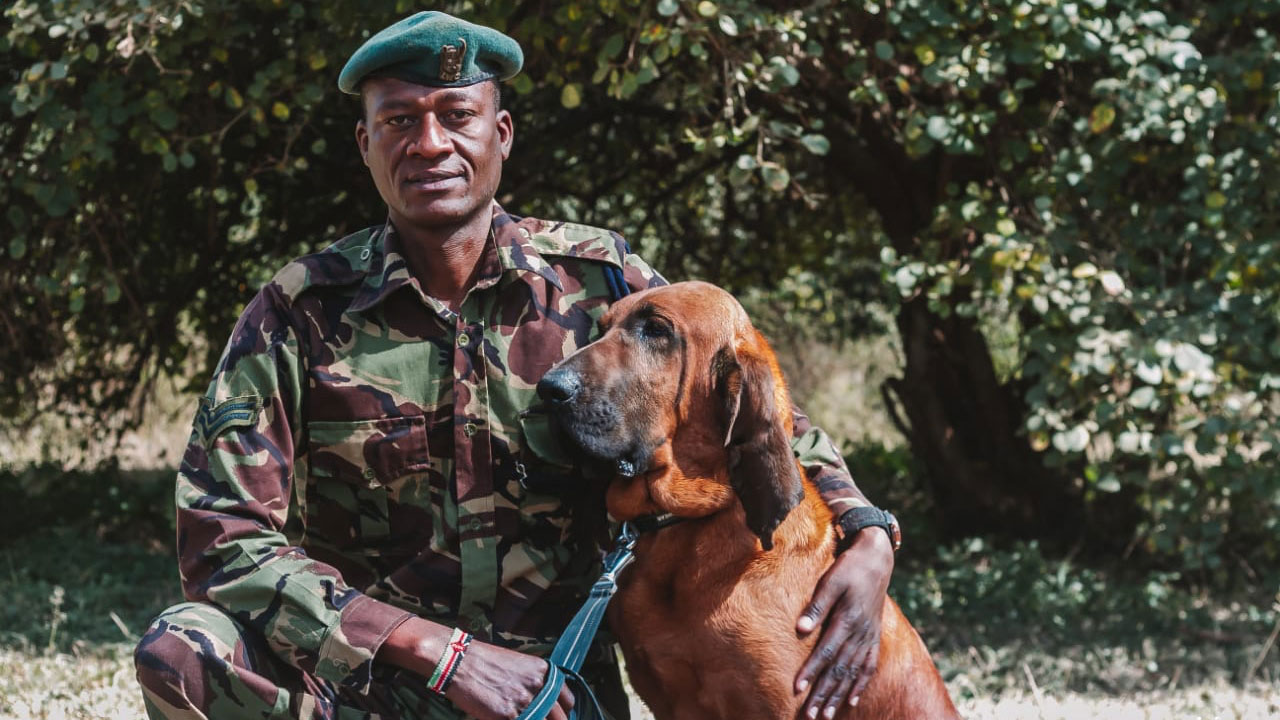 David Nkidedio with tracker dog Tipper