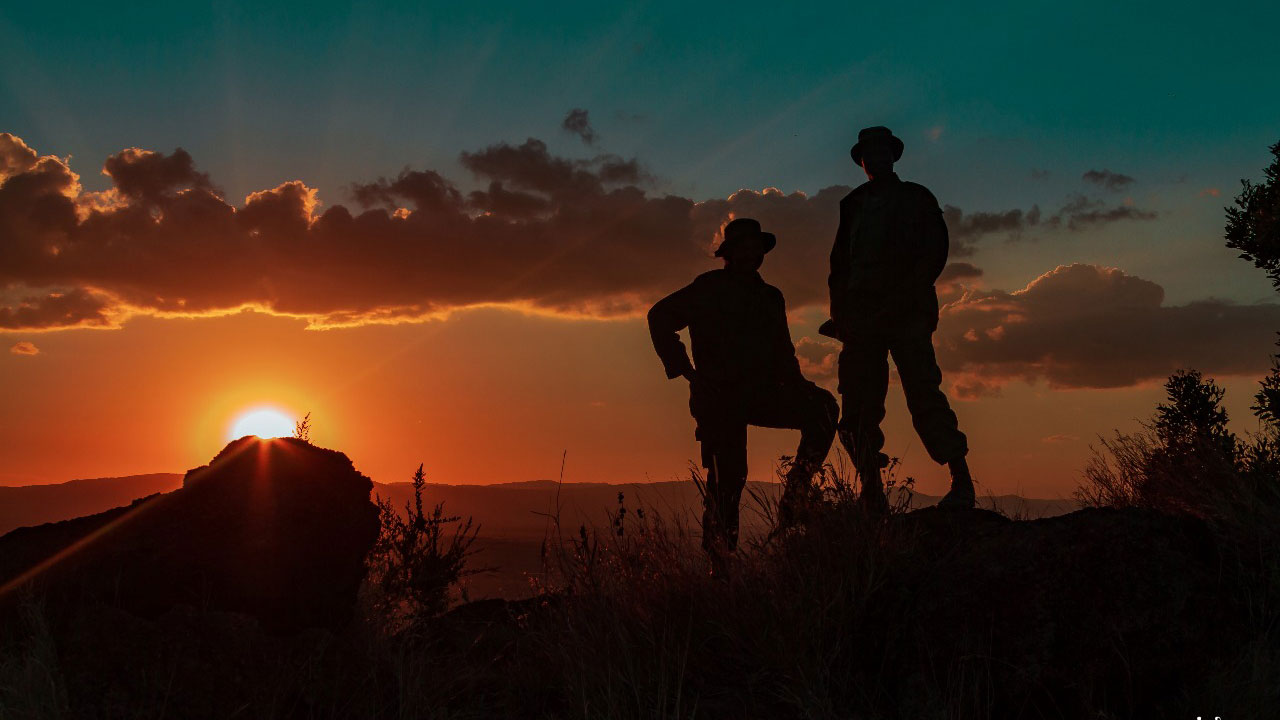 Rangers during sunset on Lewa