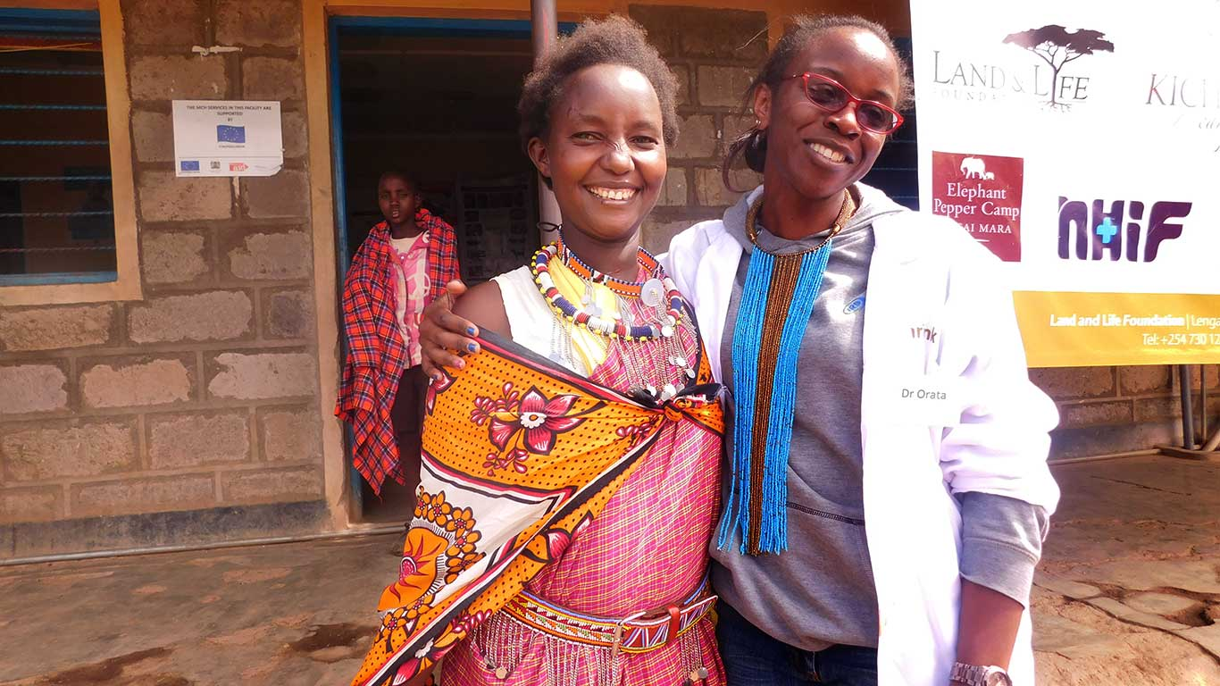 Happy doctor and patient after treatment